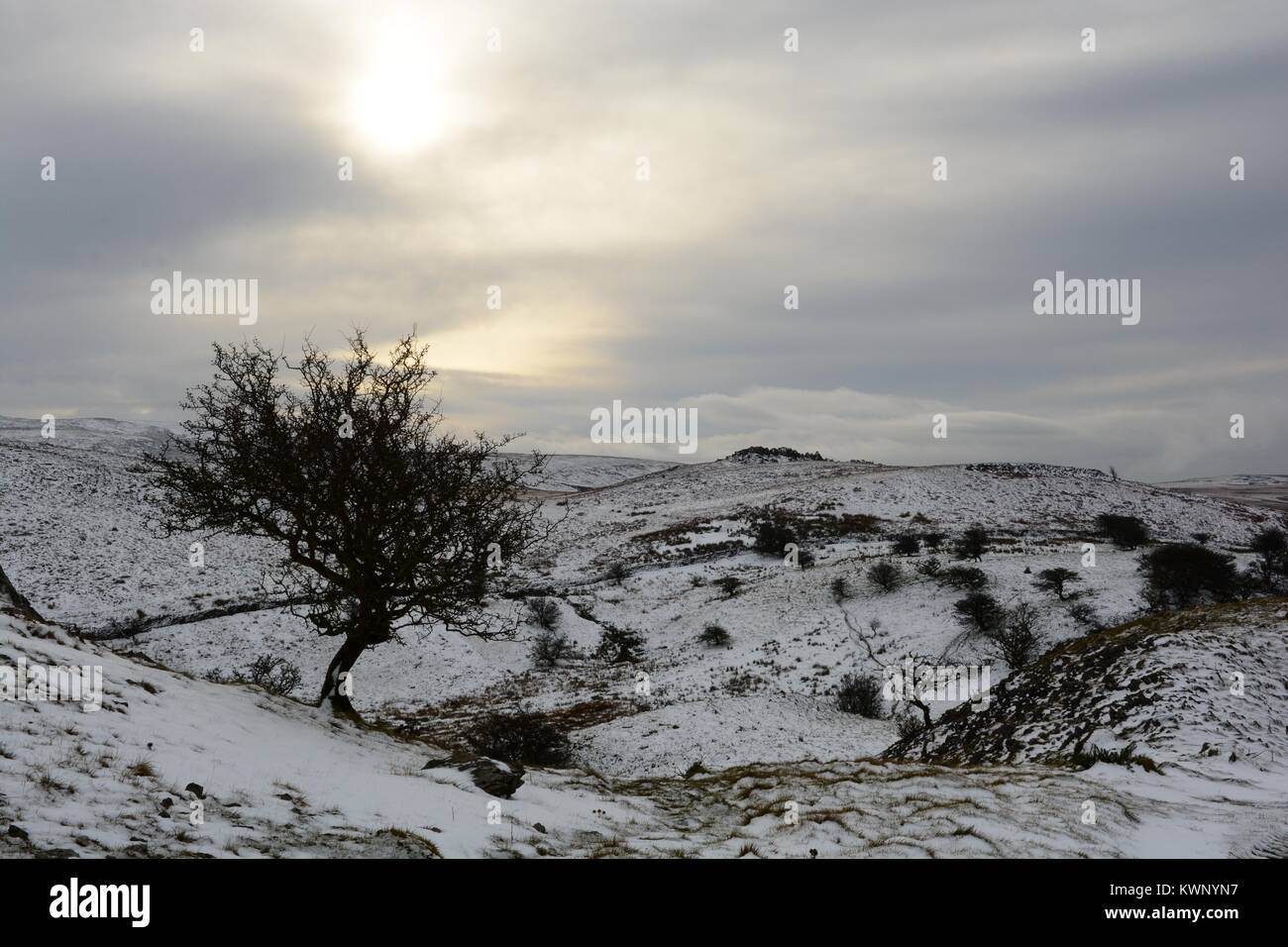 Snow filled sky over the Black mountain towards Tair Carn Isaf Brecon Beacons National Park winte Fforest Fawr Geopark Stock Photo