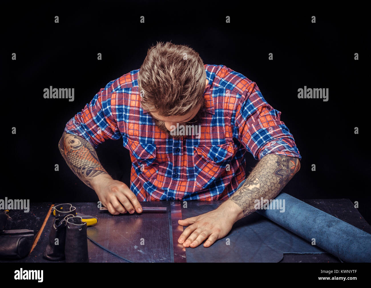 Tanner focusing on his work at the desk Stock Photo