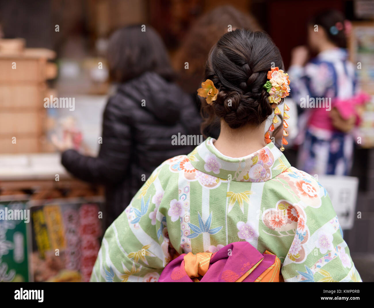 Japanese Girl In Colorful Yukata Kimono With A Pretty Hairstyle And