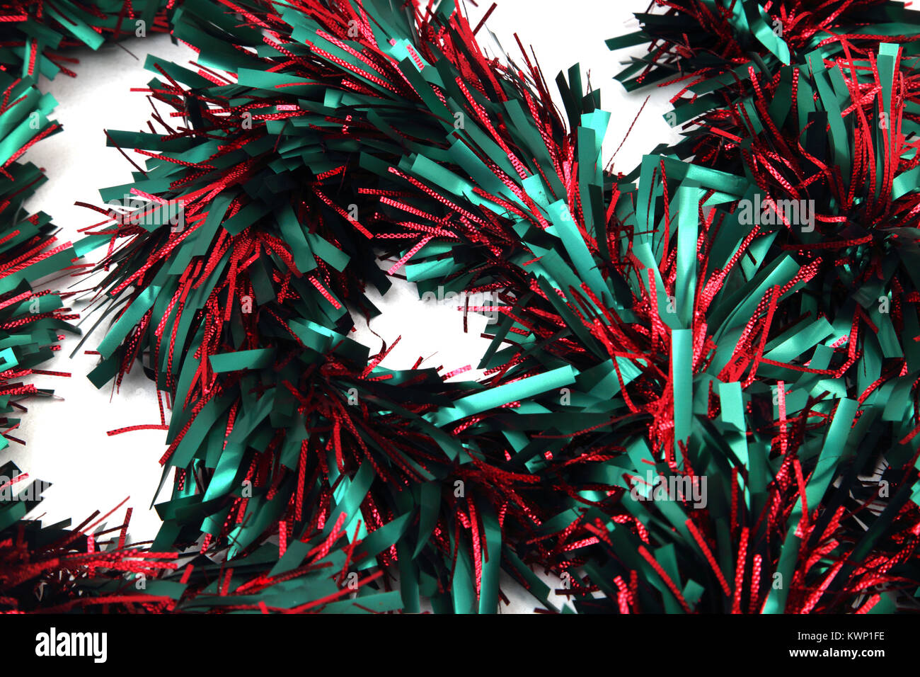 Christmas Decoration Red And Green Tinsel - Stock Image