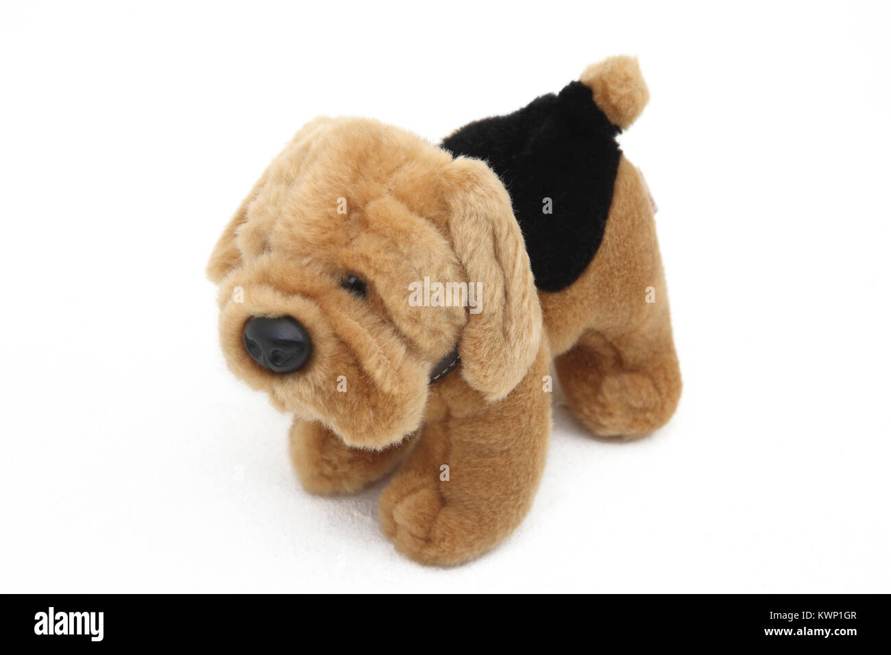 Brown and Black Soft Toy Dog By Keel Toys - Stock Image