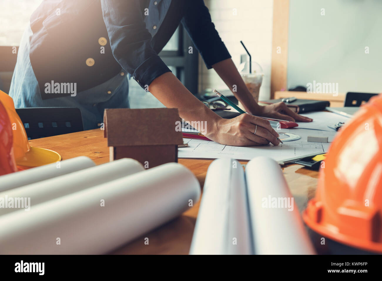 Engineer and Architect concept, Engineer Architects office team working with blueprints, Vintage Effect - Stock Image
