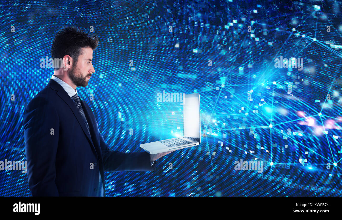 Programmer man works with a laptop on a network application Stock Photo