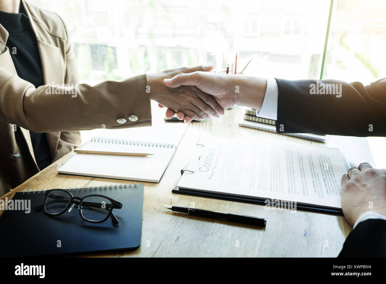 Successful job interview with boss and employee handshaking after good deal, Congratulation, merger and acquisition - Stock Image