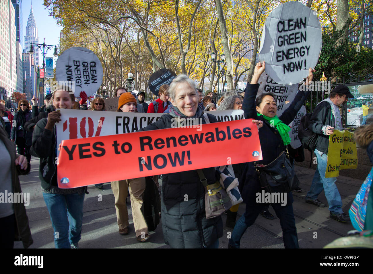 Environmental activists march in midtown Manhattan sending the message of 'Renewables Now' if we are going - Stock Image