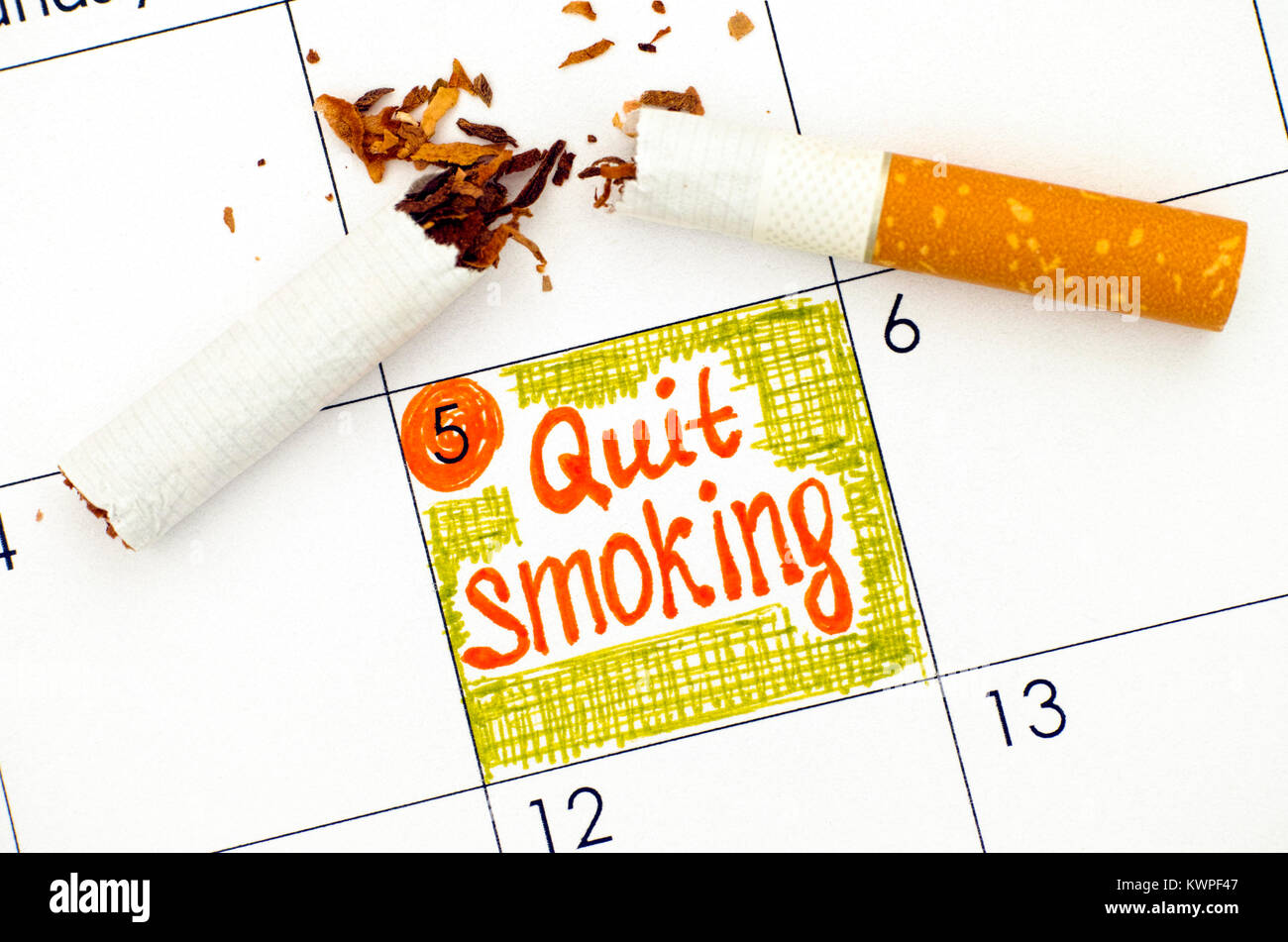 Reminder Quit Smoking in calendar with broken cigarette. Close-up. - Stock Image