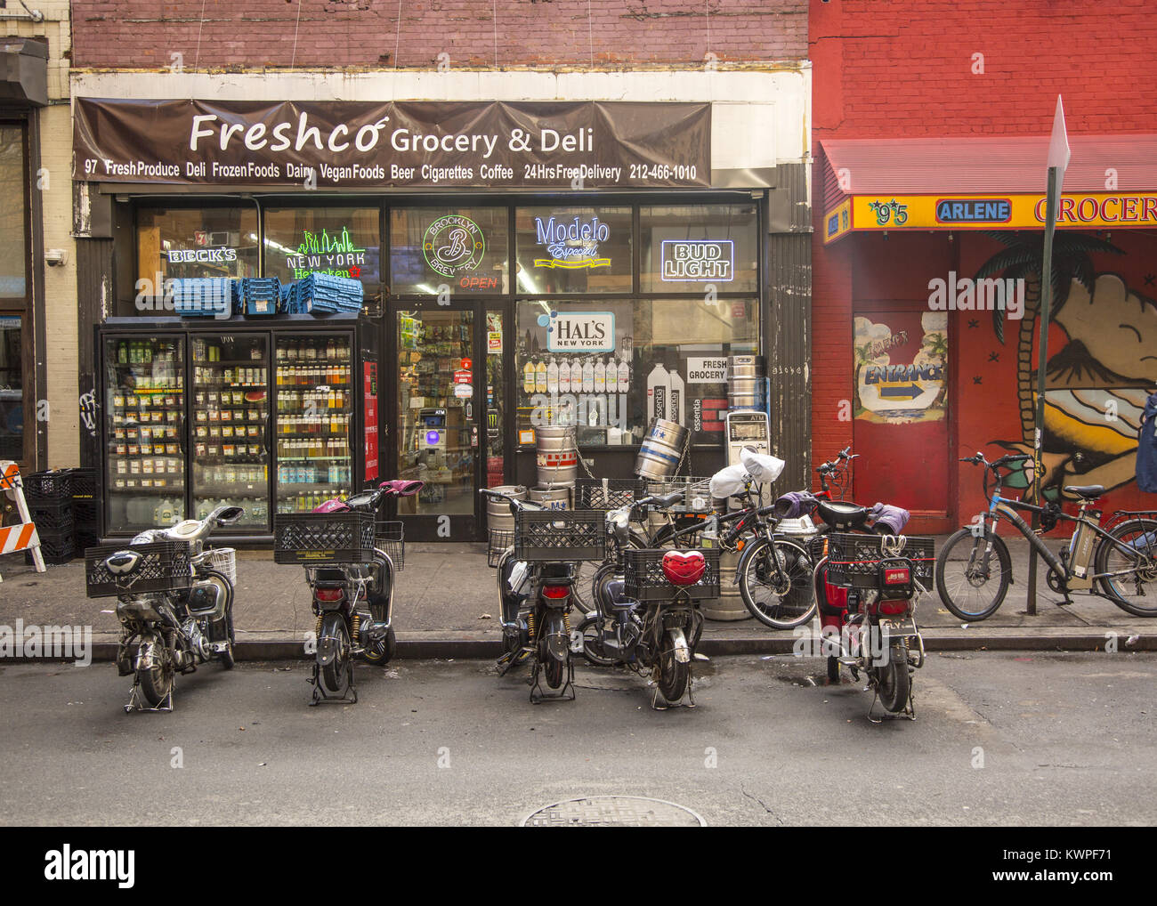 Motorized delivery bikes have taken over New York City, causing problems because they don't seem to be well - Stock Image