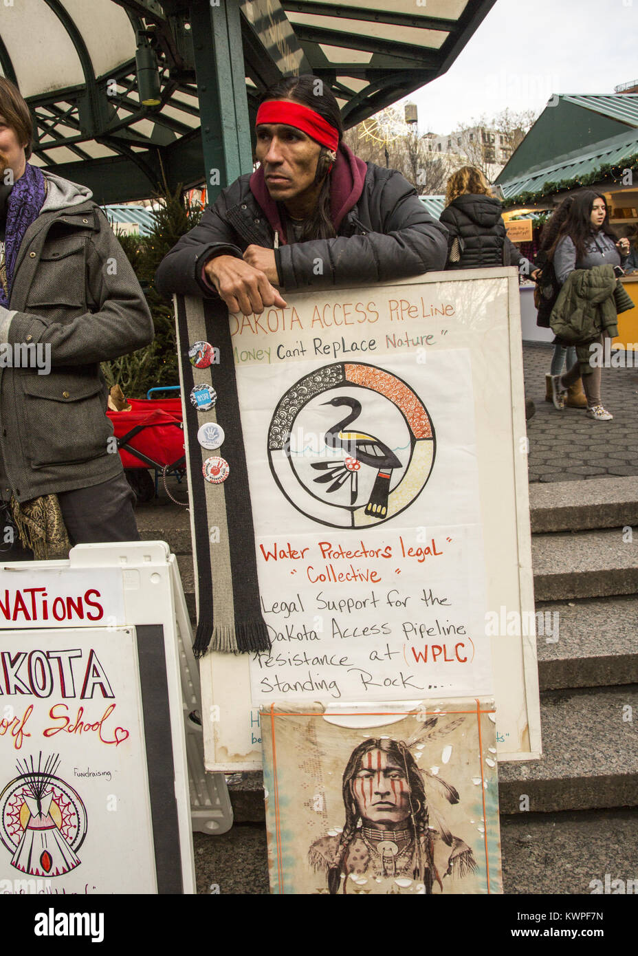Native American man from the Lakota Nation in North Dakota; advocates and tries to raise money at Union Square in Stock Photo