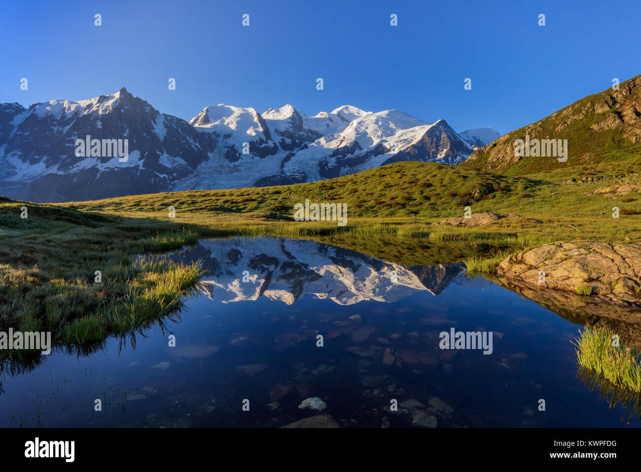 Mont Blanc massif reflected in lake. France Stock Photo