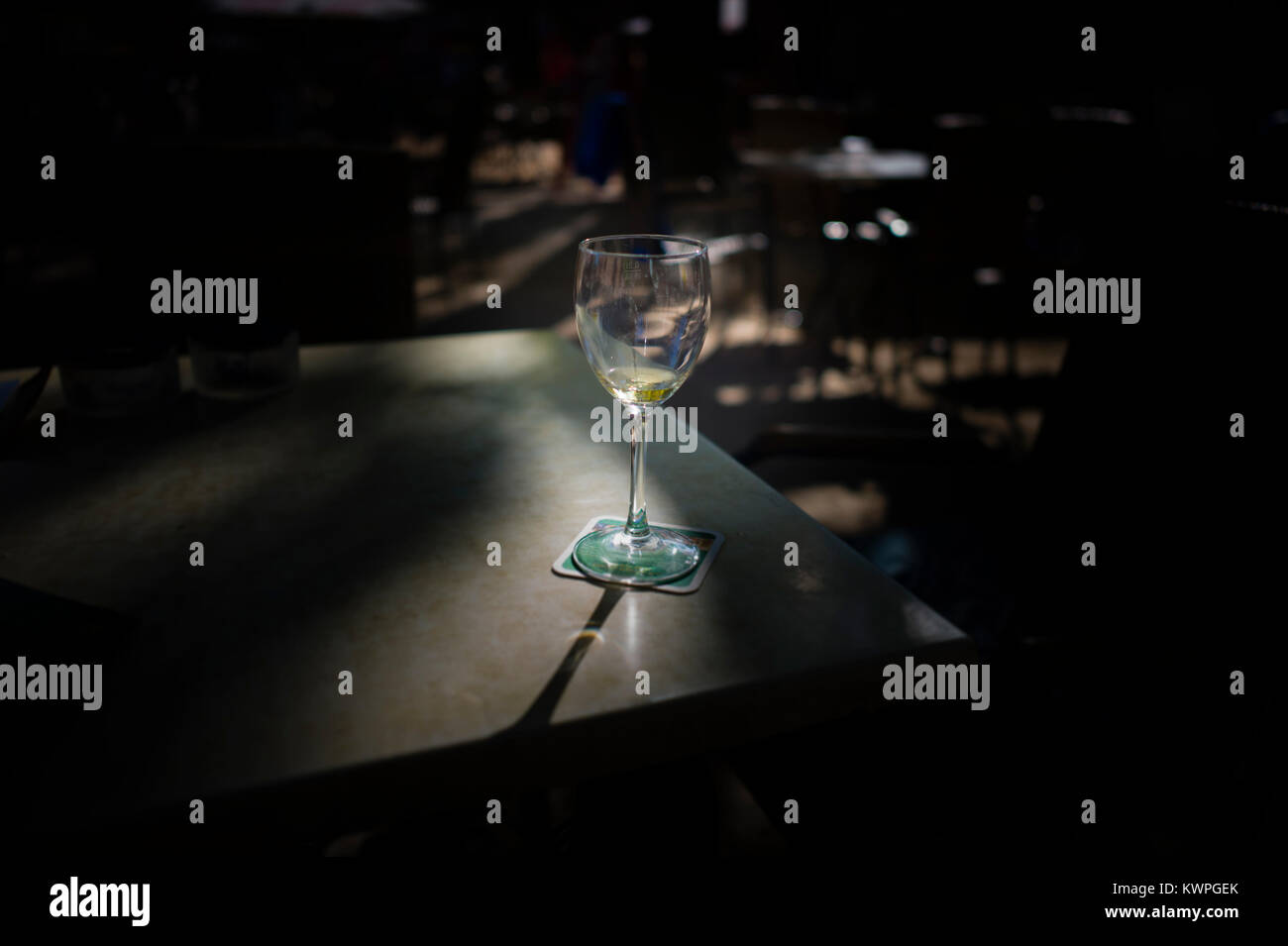 Empty wine glass and beer mat Stock Photo