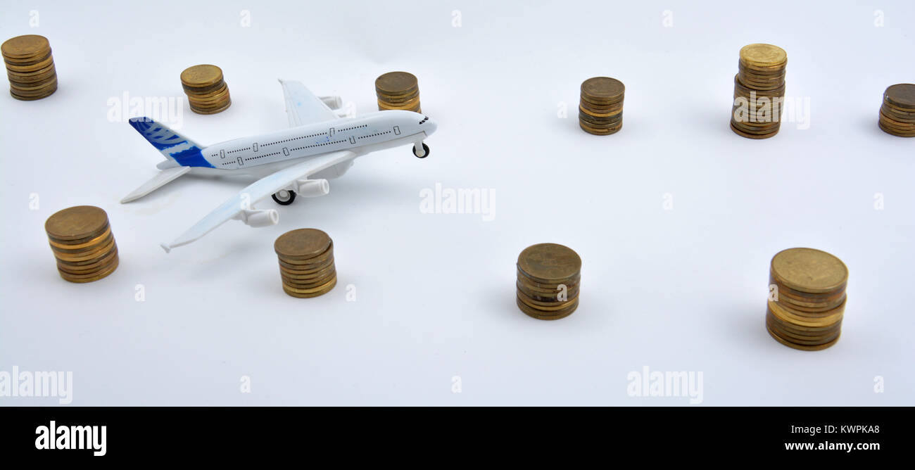 Plane plastic toy with coins isolated on white background - Stock Image