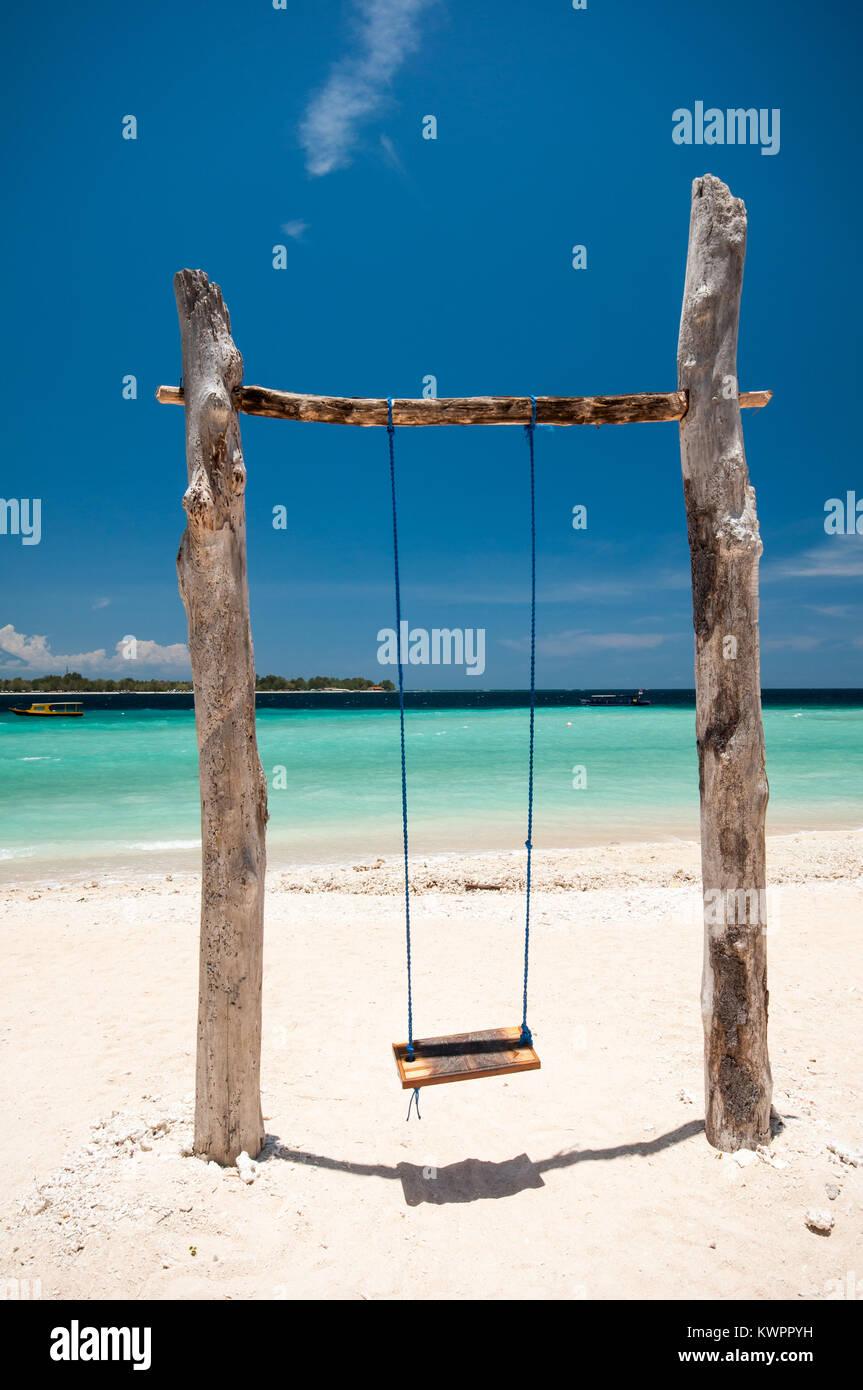 Swing on the beach,Gili Meno Island,  Lombok, Indonesia - Stock Image