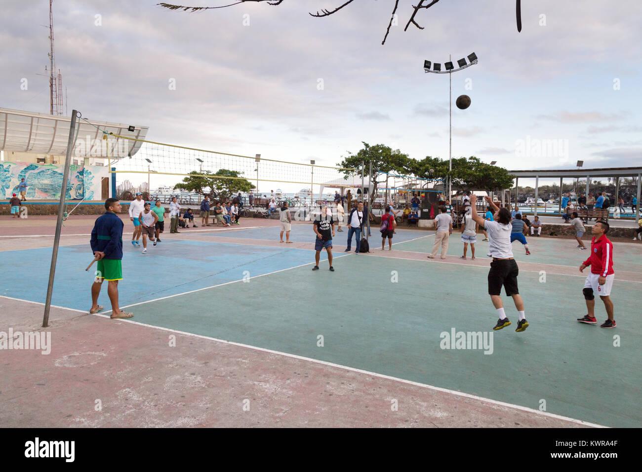 Local Galapagos people playing volleyball, Puerto Ayora, Santa cruz island, galapagos Islands, Ecuador South America - Stock Image
