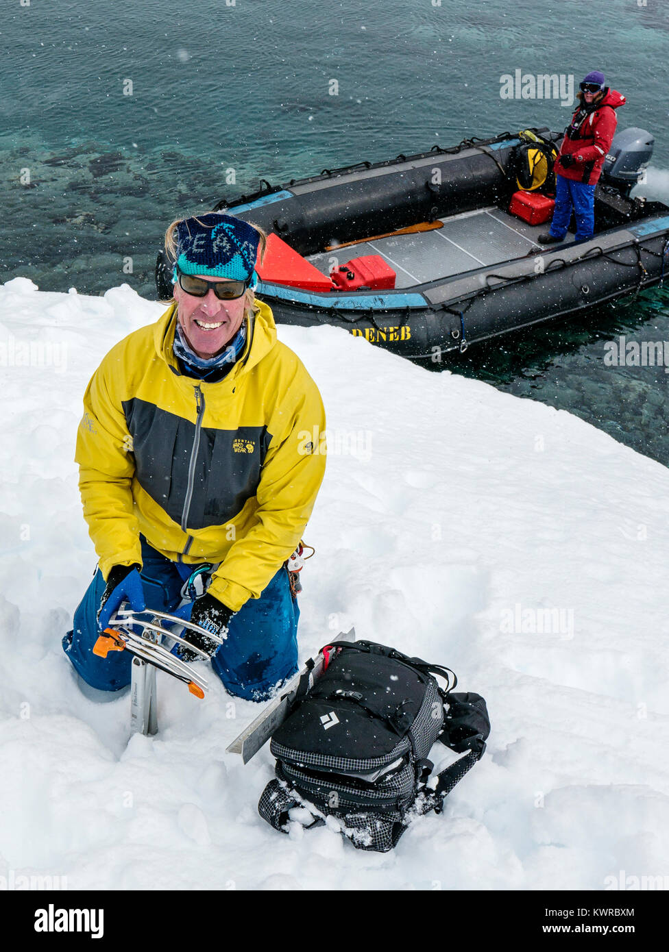 Doug Stoup; owner of Ice Axe Expeditions; helps to load large inflatable Zodiac boats shuttle alpine mountaineering - Stock Image