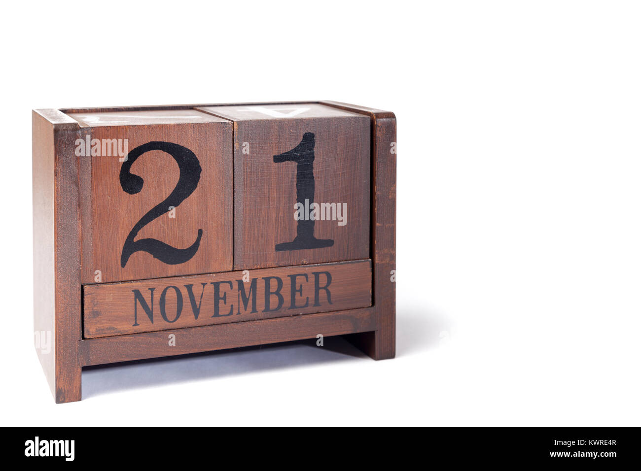 Wooden Perpetual Calendar set to November 21st - Stock Image