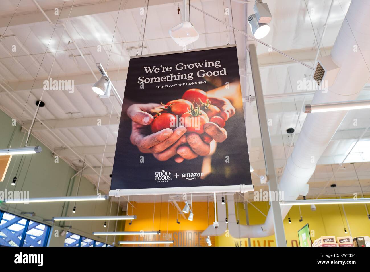 Signage at the Whole Foods Market store in San Ramon, California reading 'We're growing something good', - Stock Image