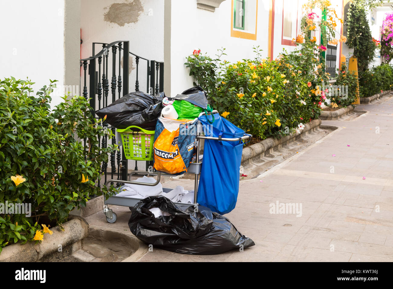 Puerto de Mogan, Gran Canaria in Spain - December 16, 2017: Cleaning trolley standing outside a gate in the street Stock Photo