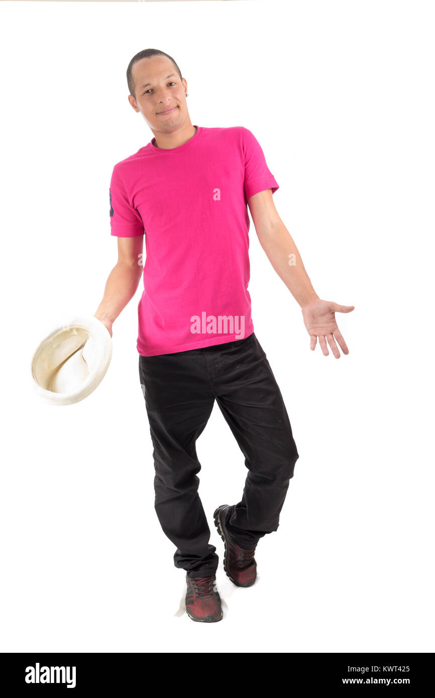 Young artist is performing. Young Brazilian is wearing a pink T-shirt. White background. Stock Photo