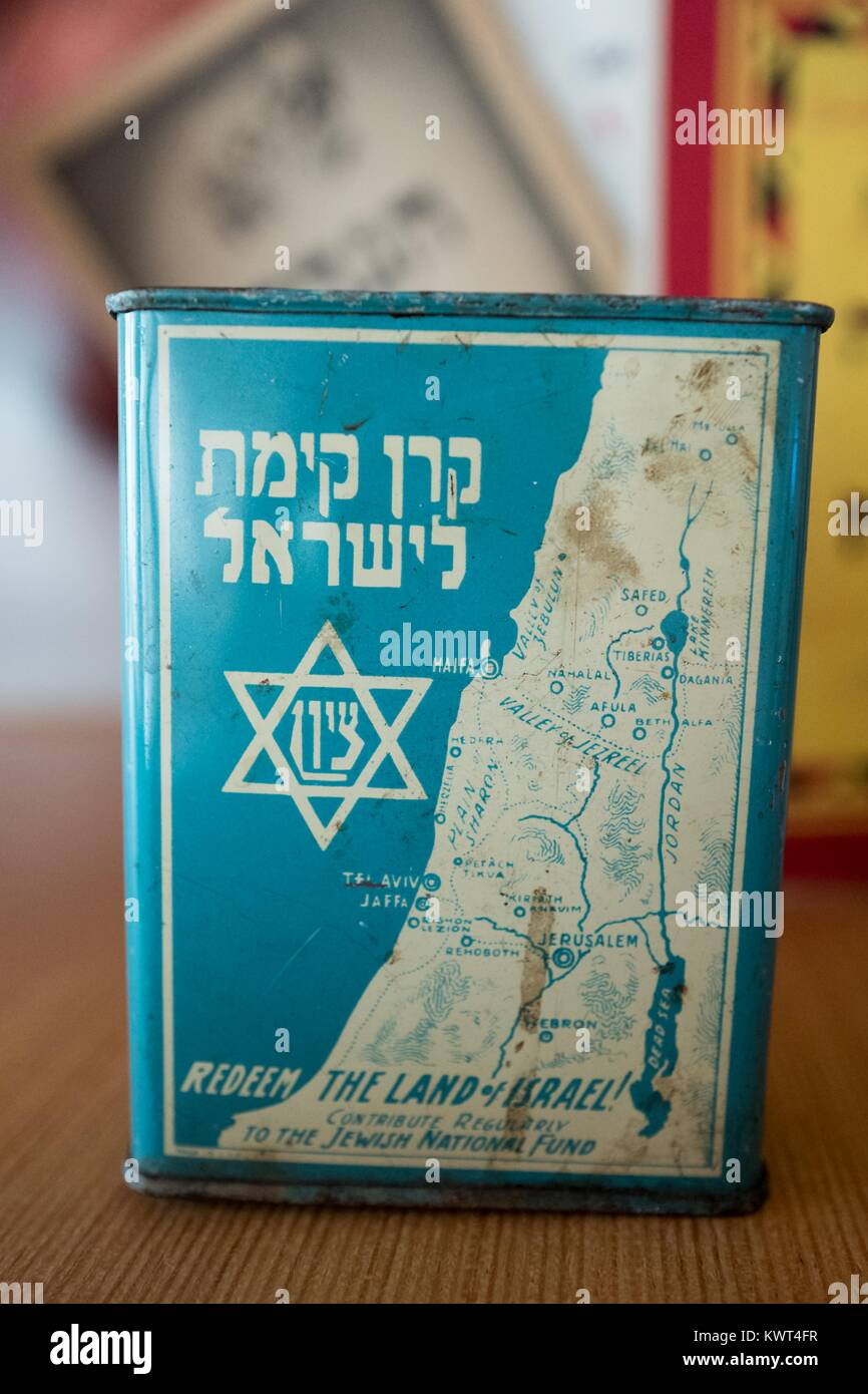 Tin with a map of the country of Israel, with text reading 'Redeem the Land of Israel, Contribute to the Jewish - Stock Image