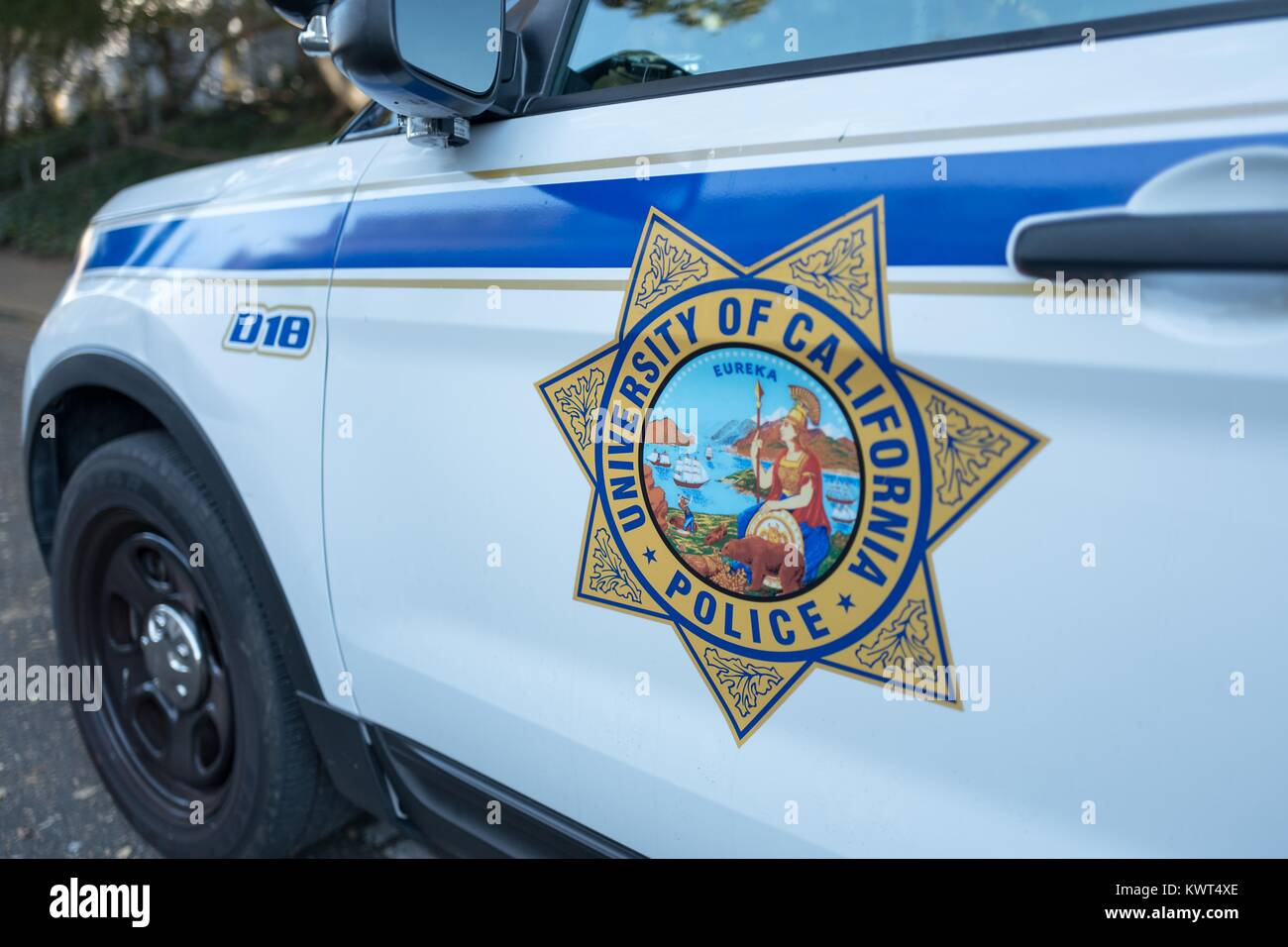 Close-up of campus police vehicle with logo at UC Berkeley, a University of California school in Berkeley, California, - Stock Image
