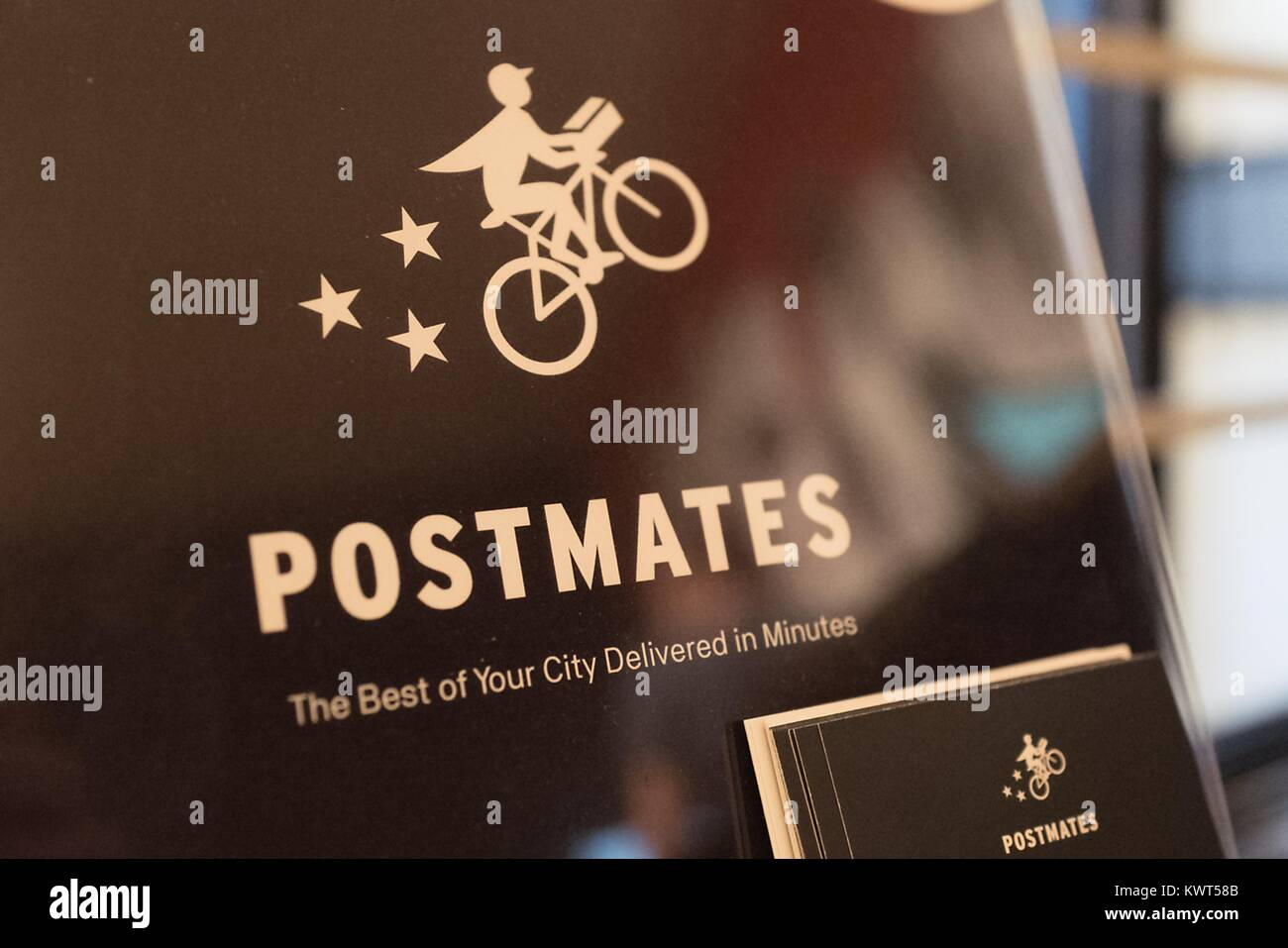 Close-up of sign for the popular app-based food and supplies deliver service Postmates, in the Gourmet Ghetto (North - Stock Image