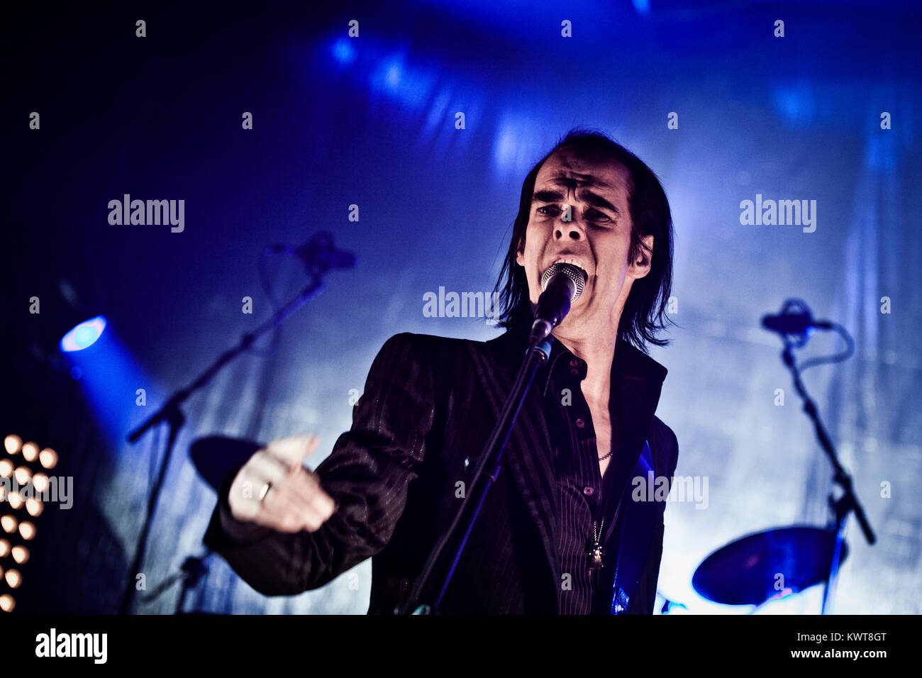 The alternative rock band Grinderman is here pictured with lead singer Nick Cave live on stage at a gig at Falconer Stock Photo
