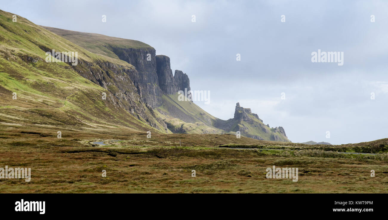 The fairytale landscape of the Quiraing, with cliffs and stacks formed by landslips, on Scotland's Isle of Skye. - Stock Image