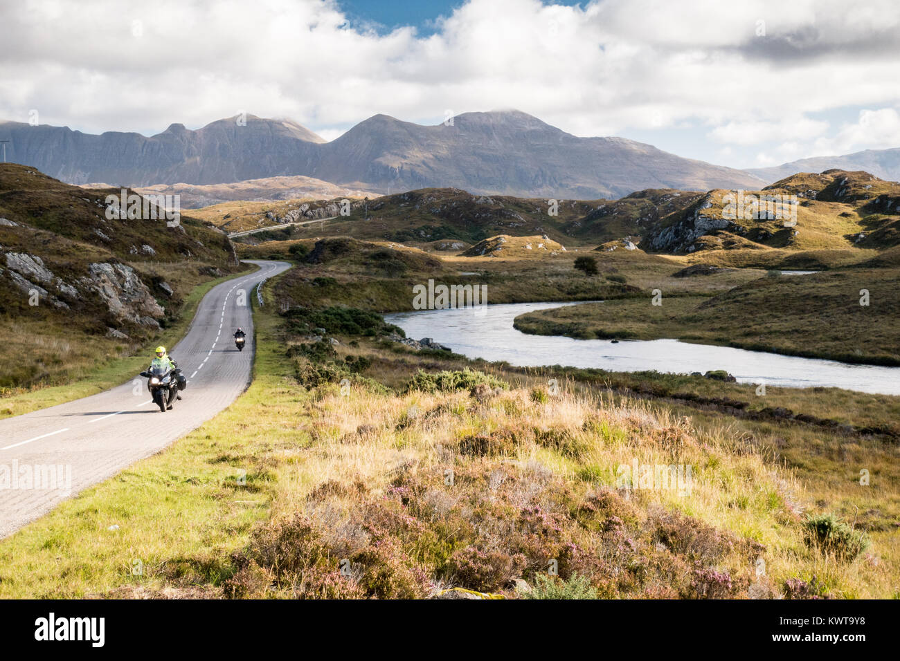 The A837 road, part of the North Coast 500 route, meanders past rivers and low hills in the glacial landscape of - Stock Image