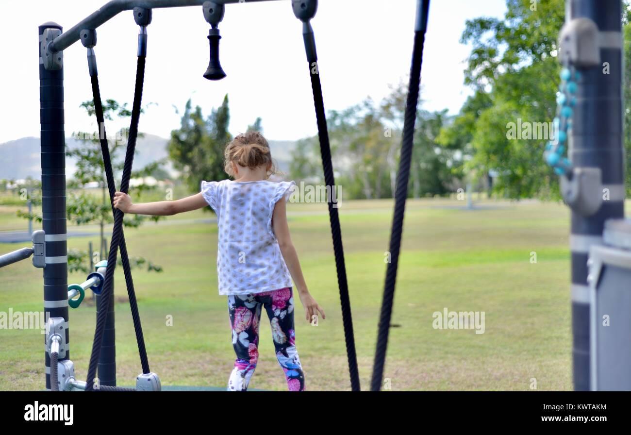 Child on playground equipment, Sherriff Park, Love Lane, Townsville, Queensland, Australia - Stock Image
