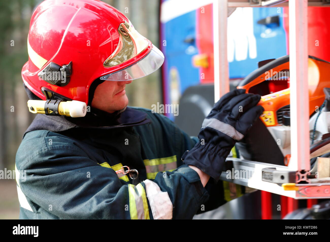 Belarus, Gomel city. Firefighting of the forest 06.04.2017.Firefighter retrieves fire hoses.The brave firefighter. - Stock Image