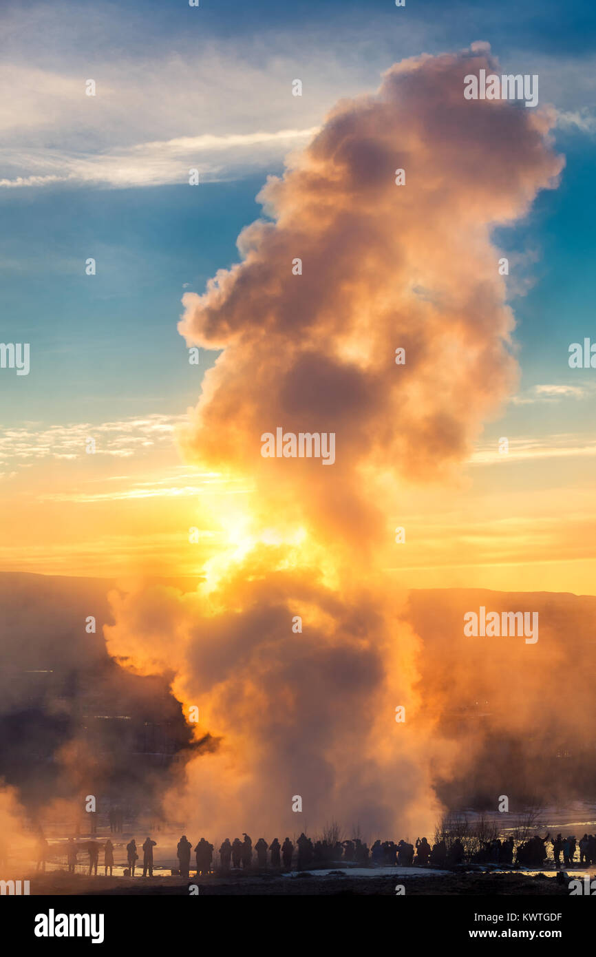 Strokkur geyser erupts at sunrise. Strokkur is one of Iceland's most famous geysers, erupting once every 6–10 - Stock Image