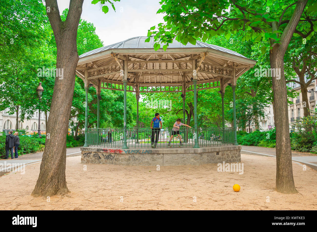 Two boys play together in a bandstand in the Boulevard Richard Lenoir in the Canal Saint-Martin area of central - Stock Image