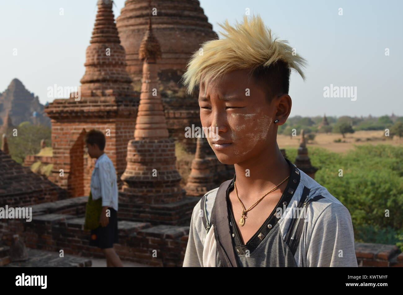 Koh Pi 11 year-old, selling his paintings in Bagan to help financially his mother at hospital. - Stock Image