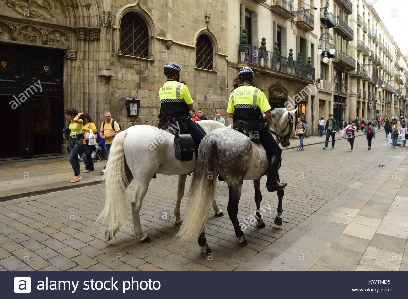 Policemen on horses in Ciutat Vella Barcelona Spain Europe - Stock Image