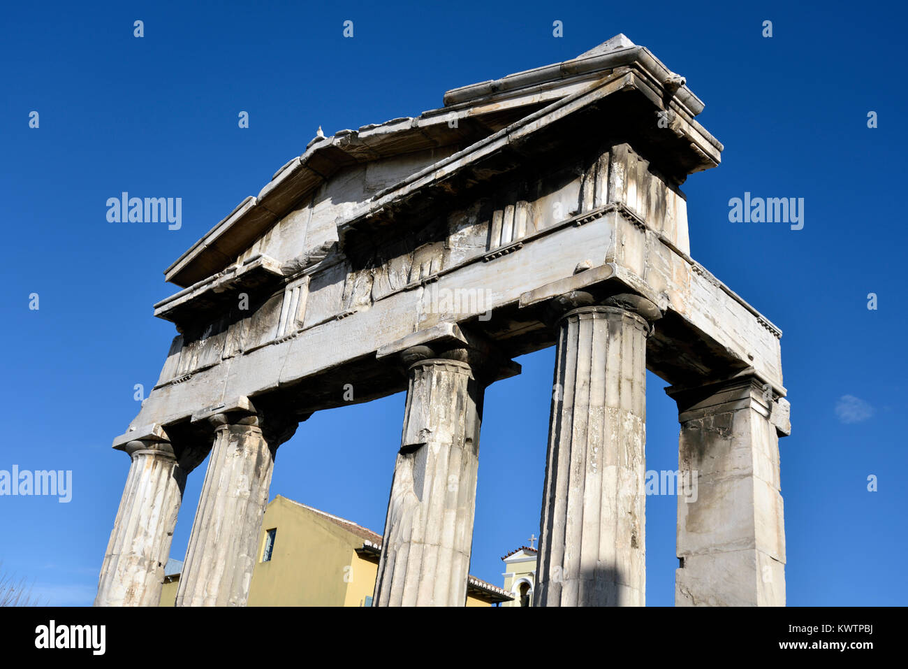 The gate of Athina Archegetis in Roman Market, Athens, Greece - Stock Image