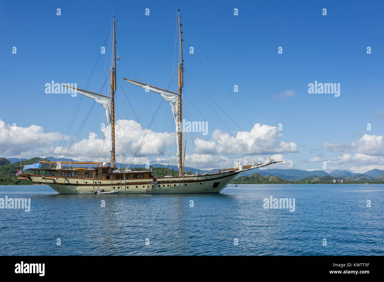 Sailing ketch Lamima off Labuan Bajo, West Flores Island, Indonesia - Stock Image