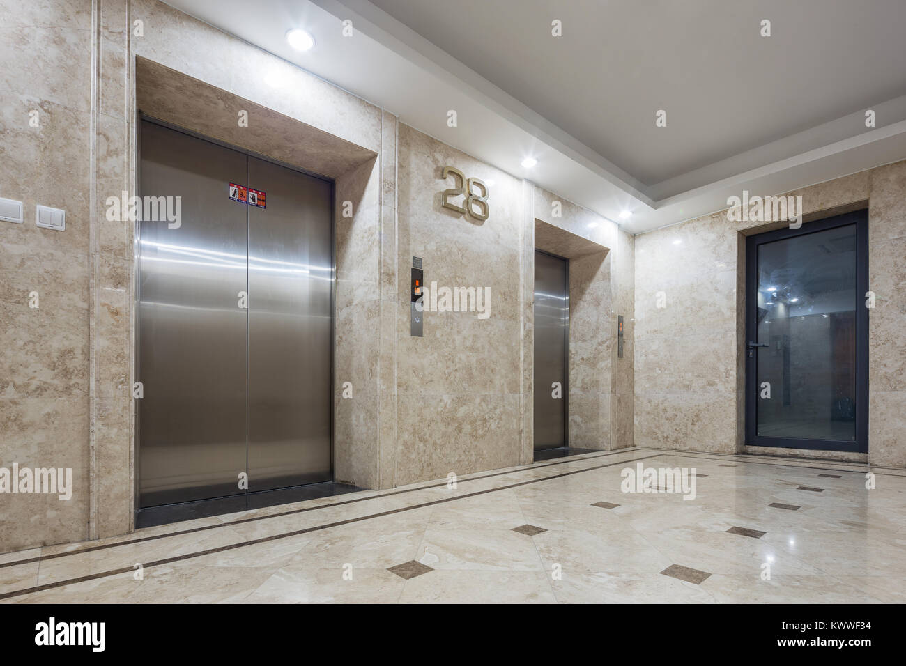 Interior of modern elevator hall in office building stock photo