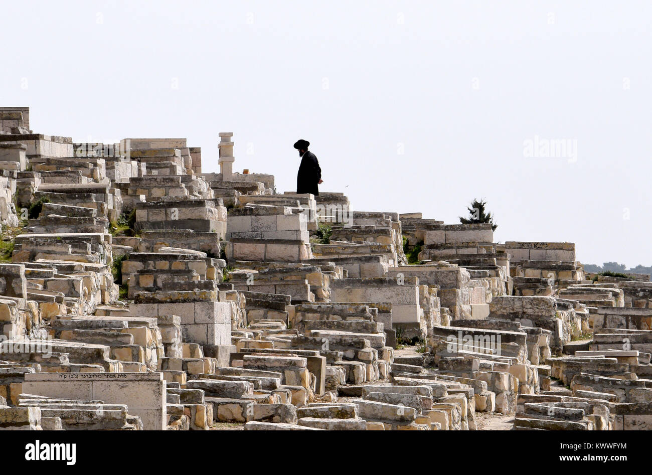 Orthodox jew on the Jewish graveyard at the Mount of Olives, Jerusalem - Stock Image