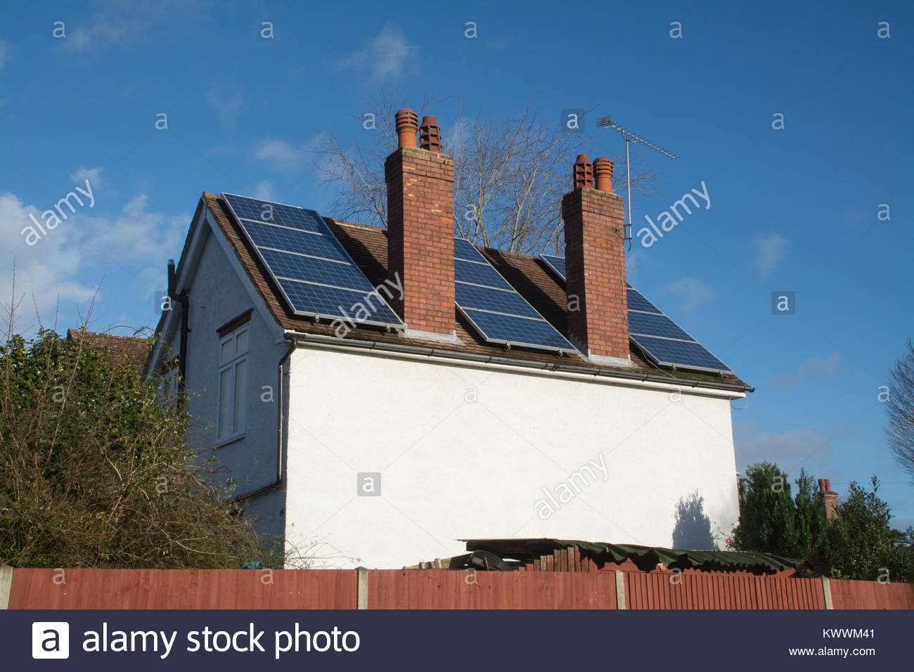 Solar panels fitted to roof of detached house in Hampshire, UK - Stock Image