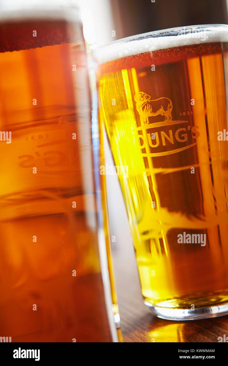 Pints of beer on table in London Pub - Stock Image