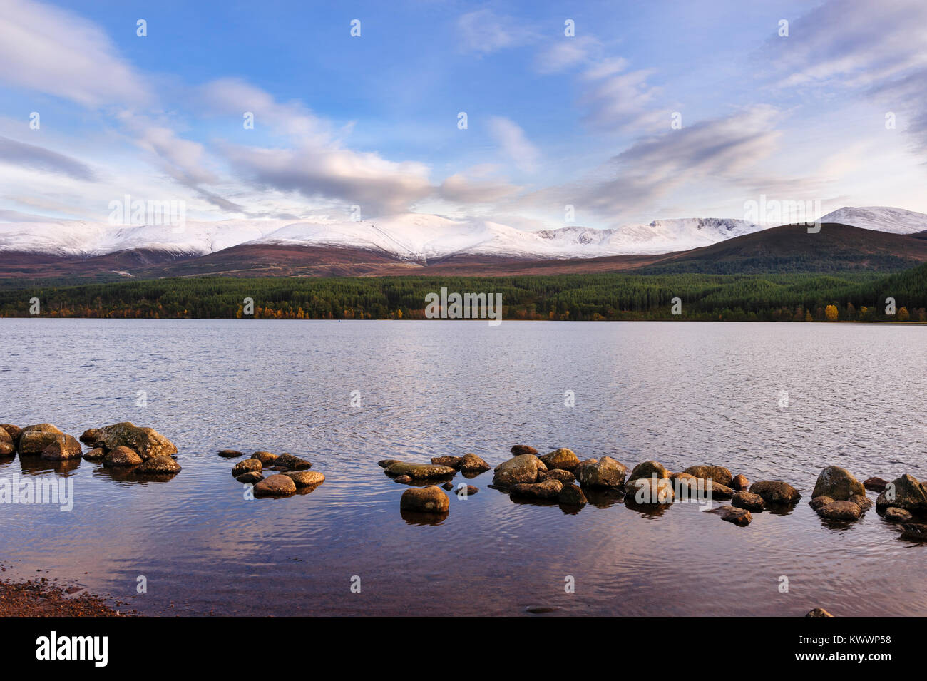 Panoramic view of Loch Morlich and the Cairngorms. This freshwater lake is in Badenoch and Strathspey area of Highland, Stock Photo