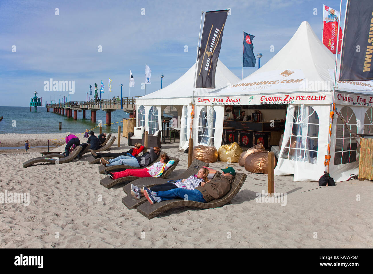 People relaxiing at the beach, pier of Zingst, Fishland, Mecklenburg-Western Pomerania, Baltic sea, Germany, Europe Stock Photo