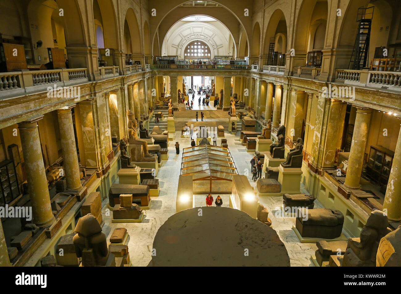 People looking at the artefacts on display inside the central hall of the Egyptian Museum of Antiquities, Cairo, - Stock Image