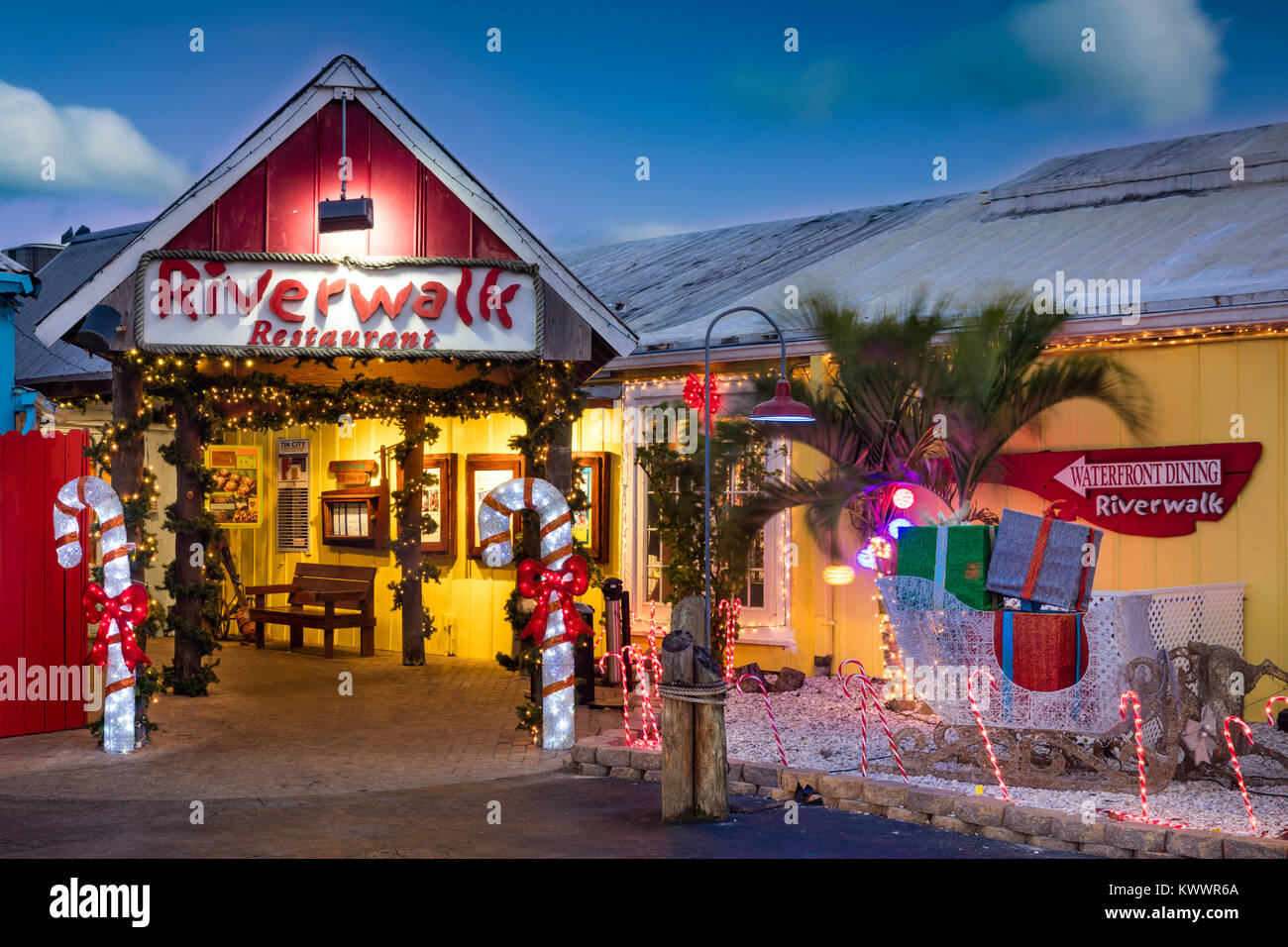 Christmas decorations at the Entrance to Riverwalk Restaurant - part of Tin City, Naples, Florida, USA - Stock Image