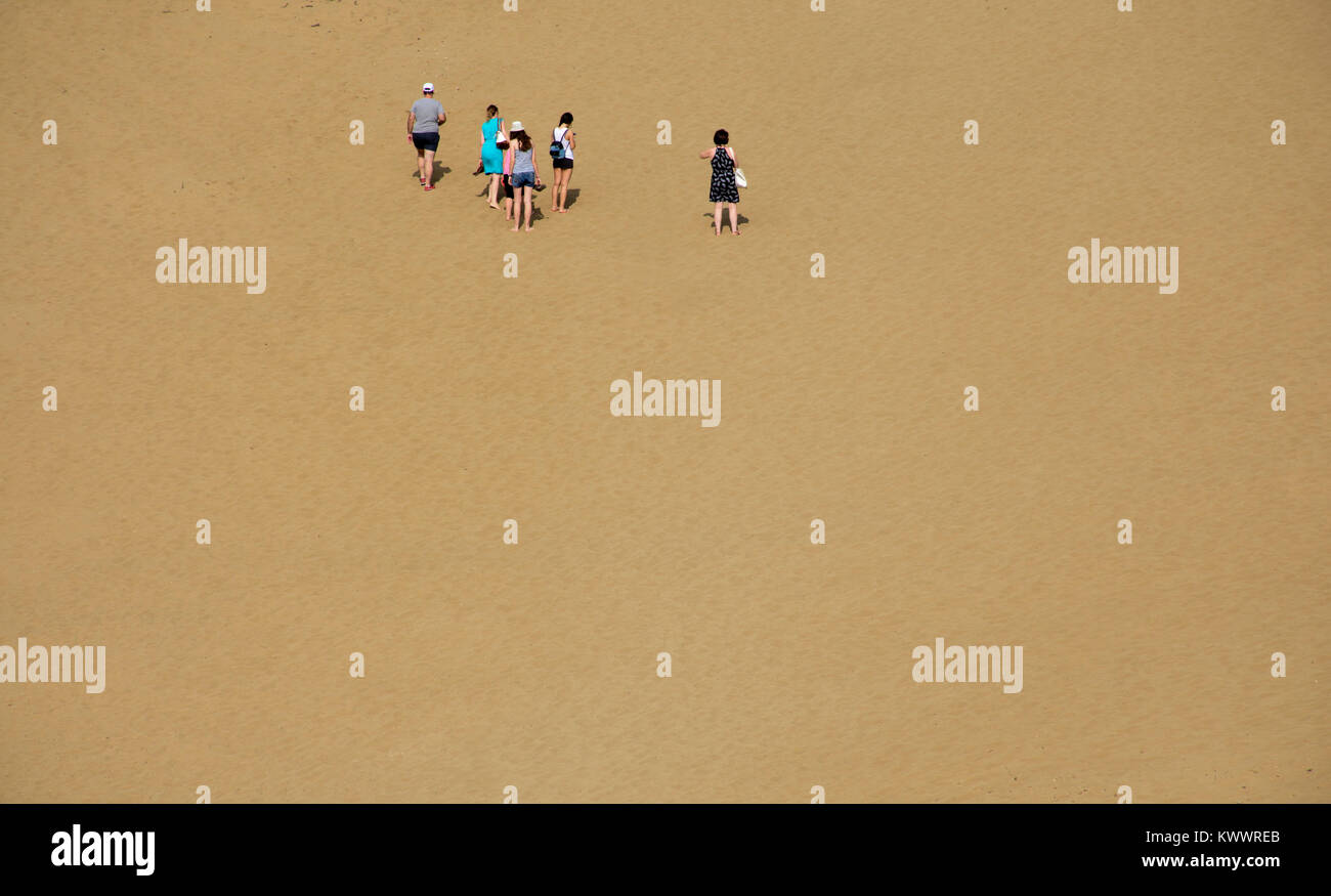 People walking on sand dunes (a place like a desert called 'Ammothines') at Lemnos island, Greece - Stock Image