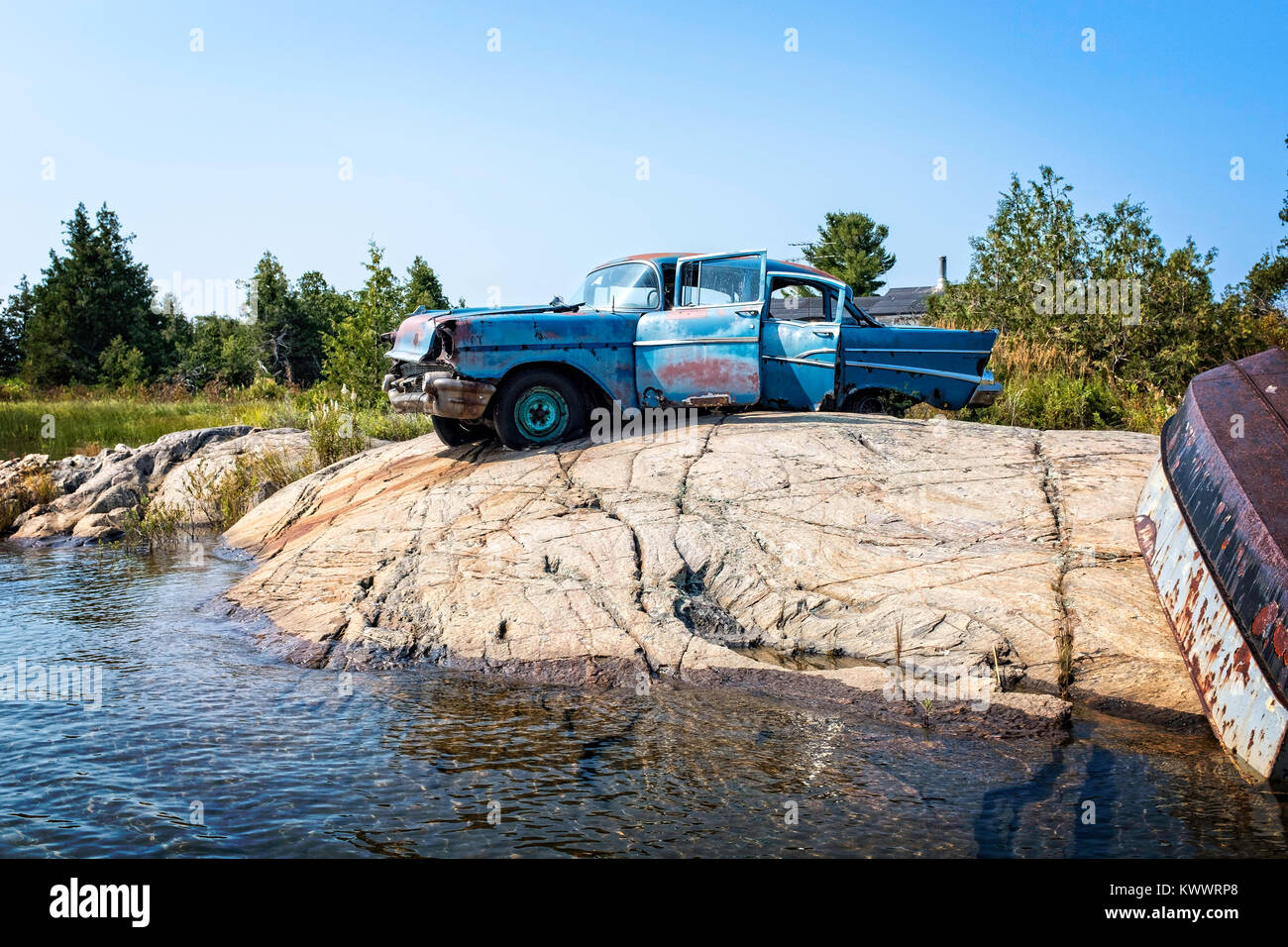 This old car is perched on a rock in Norgate Inlet, Georgian Bay, there are no roads here - Stock Image