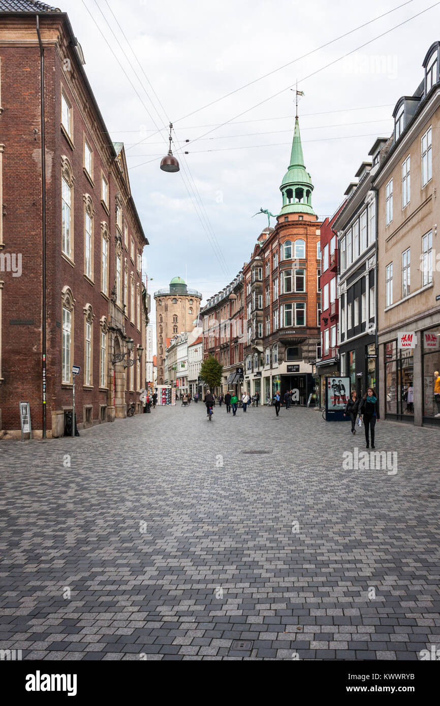 Købmagergade street, with views of the Round Tower and Varehuset Messen - a former department store, Copenhagen, - Stock Image