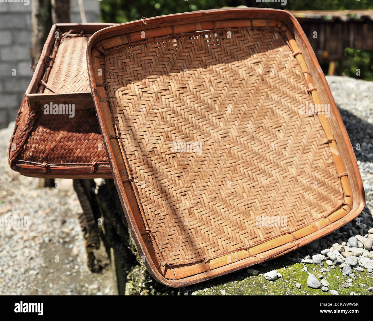 Woven Wicker And Bamboo Trays Placed In The Sun On The Pebble Covered Stock Photo Alamy