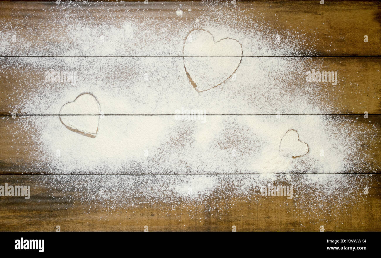 Heart shapes in flour - Stock Image