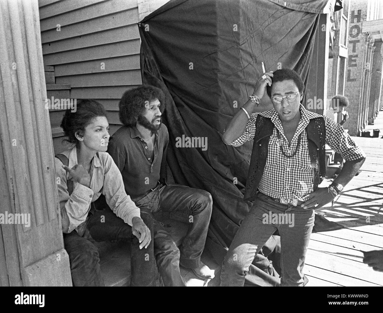 Actor Vonetta McGee (left), Max Julien (center), and director Gordon Parks Jr., on movie location in New Mexico - Stock Image